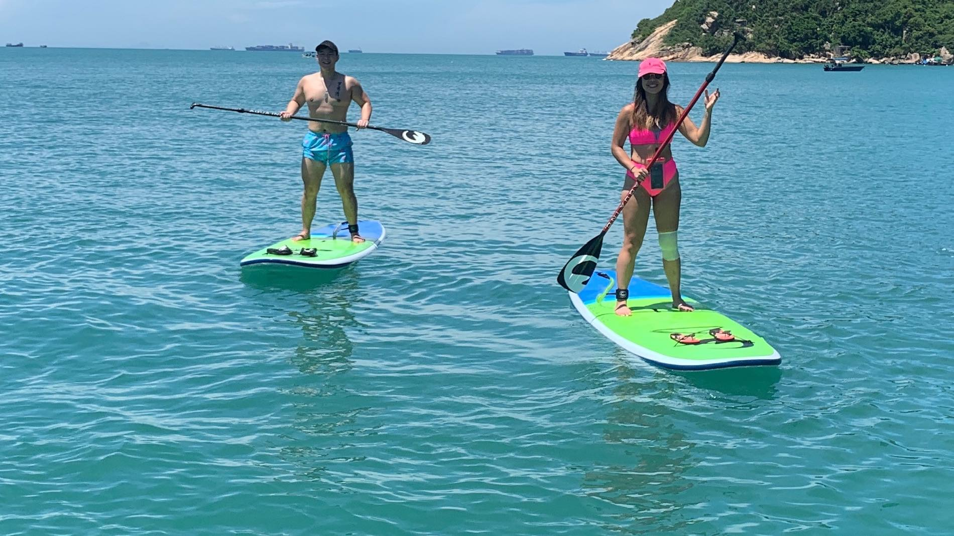 Two Happy Stand Up Paddleboarders with Aqua Terra Performance